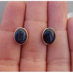 Zilveren oorknoppen gezet met blauwe Goudsteen