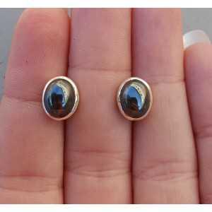 Zilveren oorknoppen gezet met Hematiet