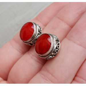 Silver oorknoppen set with Coral in carved setting