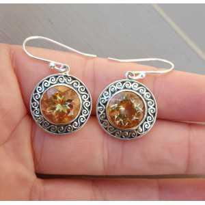Zilveren oorbellen gezet met ronde Citrien