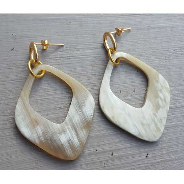 Earrings with a pendant of buffalo horn