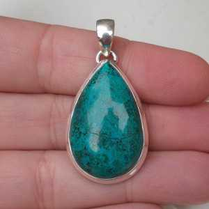 Silver pendant set with oval shape Chrysocolla