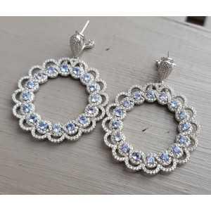 Zilveren oorbellen gezet met Zirkonia en Tanzaniet