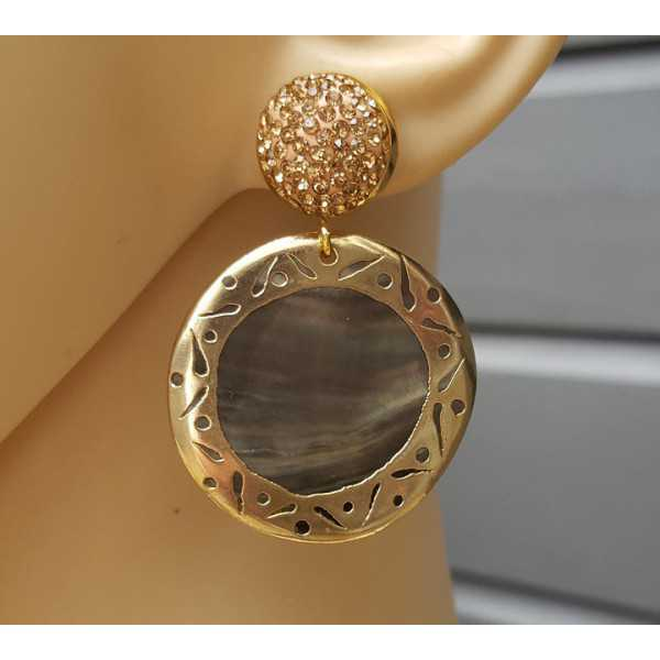 Gouden oorbellen met gouden kristallen en schelp
