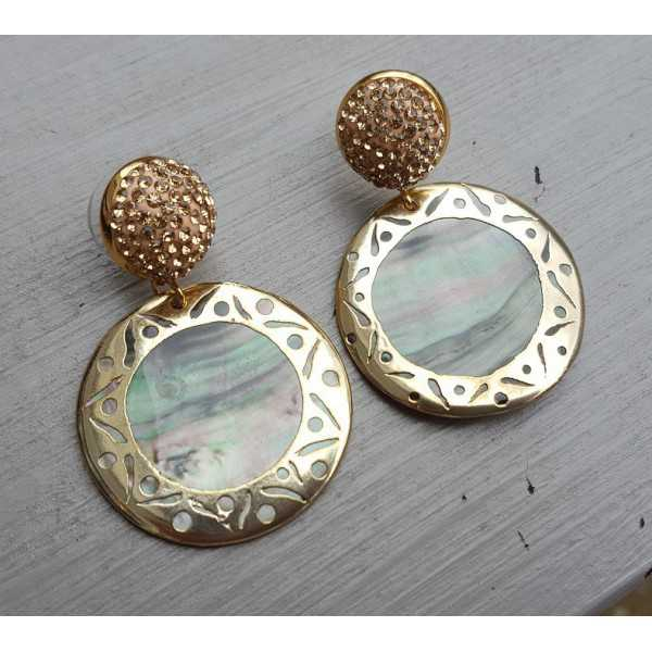 Gold earrings with golden crystal and shell