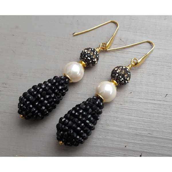 Vergoldete Ohrringe mit Kristallen, Perlen und Tropfen Onyxen