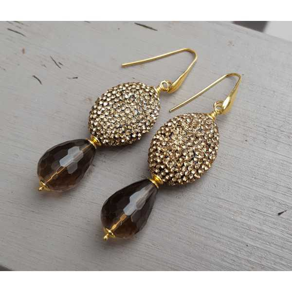 Gold plated earrings with Smokey Topaz and gold crystals