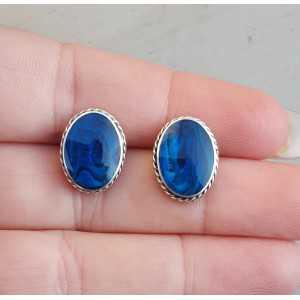 Zilveren oorknoppen gezet met blauw Abalone schelp