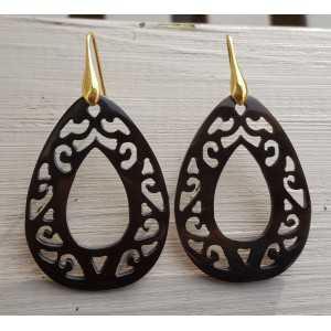 Earrings with carved black teardrop shaped buffalo horn