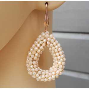 Oorbellen met open druppel van ivoor witte kristallen