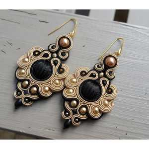 Earrings with large black with beige handmade pendant