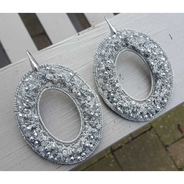 Silver earrings with oval gray pendant of silk thread and crystals