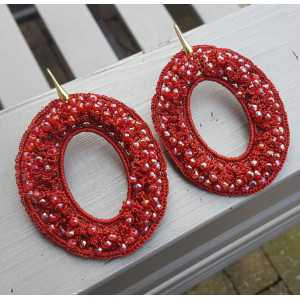 Gold plated earrings with oval red pendant of silk thread and crystals