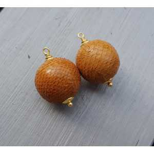 Gold plated pendant set with sphere of orange Snakeskin