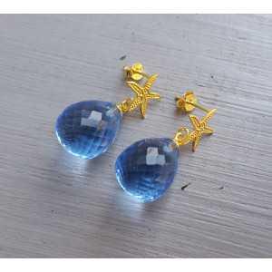 Oorbellen met zeester en blauw Topaas quartz briolet