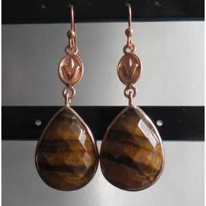 Gold plated earrings made with oval shape faceted tiger's eye