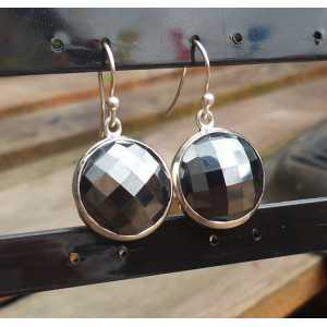 Silver earrings set with round faceted Hematite