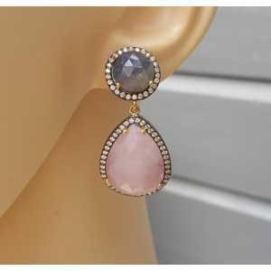 Zilveren oorbellen gezet met roze en blauwe Saffier