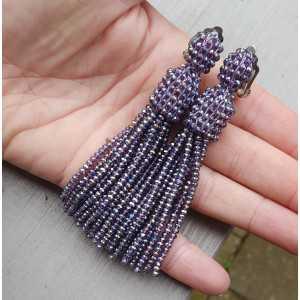 Quaste Ohrringe mit lila Kristallen