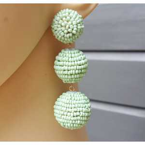 Gold plated earrings balls with mint green beads