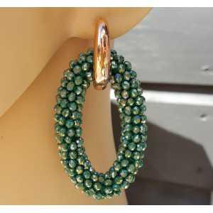 Creolen met grote ovale van metallic groene Kristallen