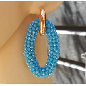 Creolen met grote ovale Turkoois kleurige Kristallen