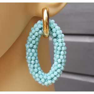 Creolen met grote ovale van aqua blauwe Kristallen
