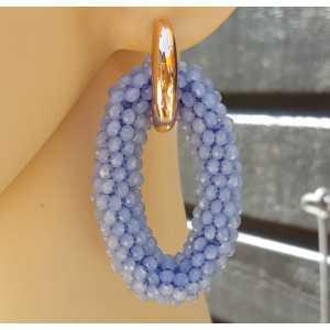 Creolen met grote ovale van licht blauwe Kristallen