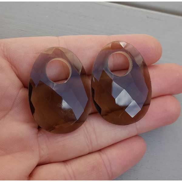 Creole earrings set with a oval Smokey Topaz