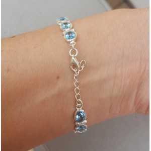 Zilveren armband met ovale facet geslepen blauwe Topazen