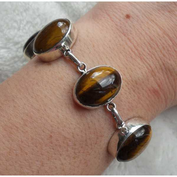 Silver bracelet set with cabochon cut tiger's eye