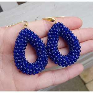 Vergoldete Ohrringe mit offenem Tropfen Saphir blau Kristalle