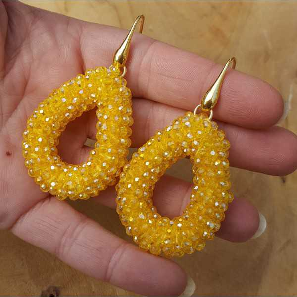 Gold plated earrings with open drop yellow crystals