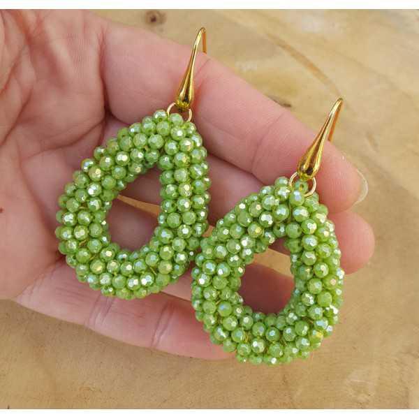 Vergoldete Ohrringe mit offenem Tropfen grüne Kristalle