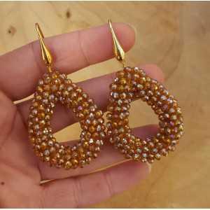 Goud vergulde oorbellen met open druppel van kristallen