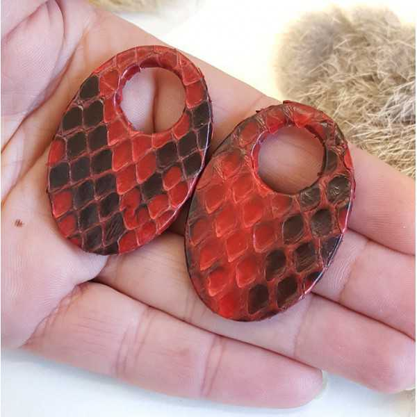 Creole earrings set with oval shaped pendant of dark red Snakeskin