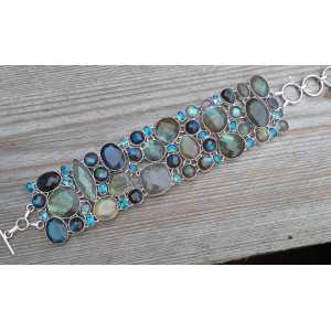 Silver bracelet set with faceted Labradorite and blue Topazes