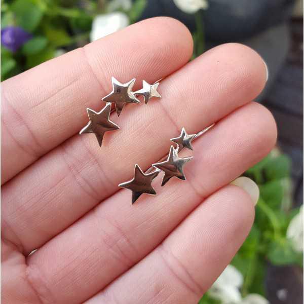 Zilveren earclimber met zilveren sterren