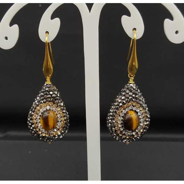 Earrings set with tiger's eye and black crystals