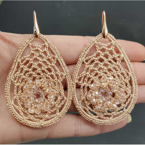 Earrings with salmon colored pendant of silk thread and crystals