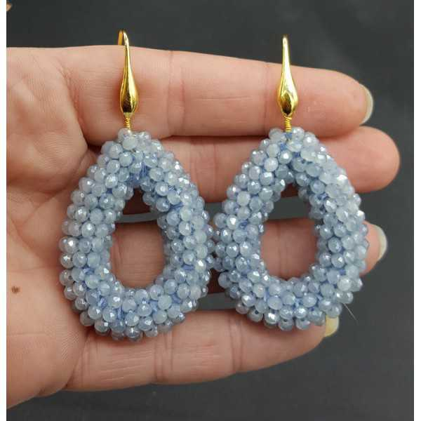 Goud vergulde oorbellen open druppel van licht blauwe sparkling kristallen