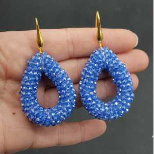 Gold plated earrings with open drop light blue sparkling crystals