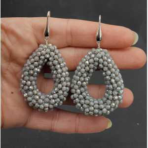 Zilveren oorbellen open druppel van grijze kristallen