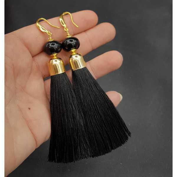 Vergoldete Ohrringe mit schwarzer Quaste und Onyx
