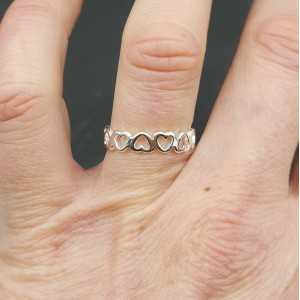Zilveren ring band met hartjes verstelbaar