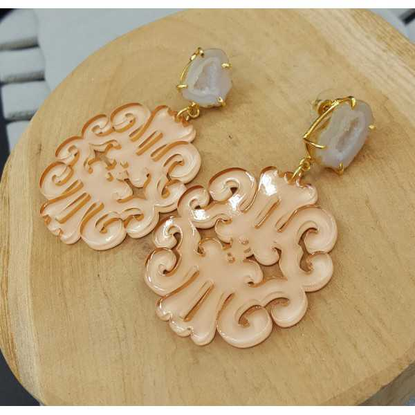 Gold plated earrings with salmon colored resin pendant and Agate geode