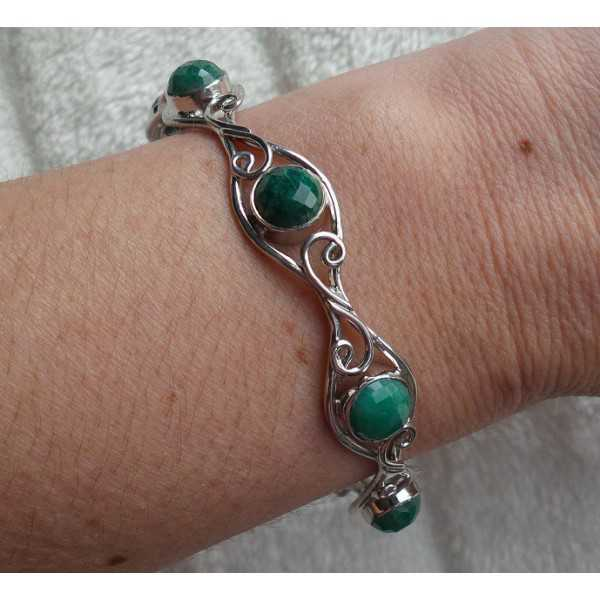 Silver bracelet set with round Emerald stones