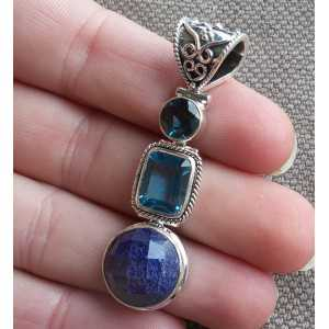 Silver pendant set with round Sapphires and blue Topazes