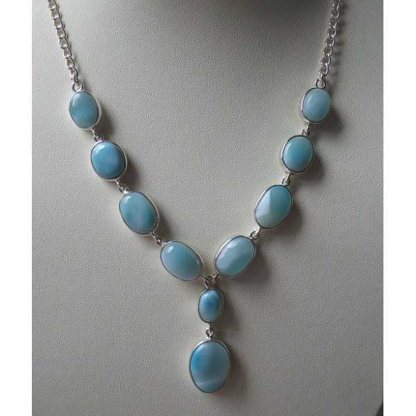 Silver necklace set with cabochon cut Larimar.