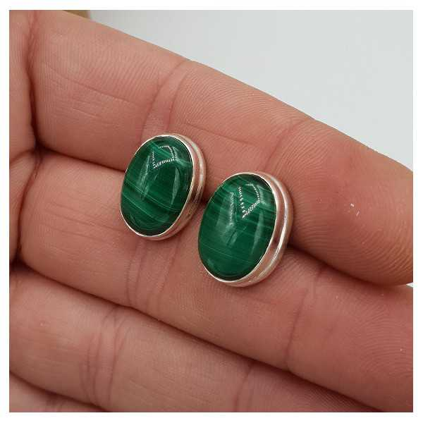 Silver oorknoppen set with oval cabochon Malachite